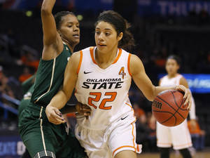 Photo - Oklahoma State's Brittney Martin (22) goes around South Florida's Courtney Williams (10) during the All-College Classic women's basketball game between Oklahoma State University and South Florida at Chesapeake Energy Arena in Oklahoma City, Okla., Saturday, Dec. 14, 2013. Photo by Bryan Terry, The Oklahoman