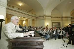 Photo - Charles Campbell speaks at the state Capitol today. Photo by Steve Gooch
