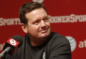 Photo - Bob Stoops talks with the press before the start of Spring Football at the University of Oklahoma (OU) on Thursday, March 7, 2013 in Norman, Okla.  Photo by Steve Sisney, The Oklahoman
