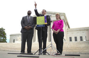Photo - Rev. Dr. Rob Schenck, of Faith and Action, center, speaks in front of the Supreme Court with Raymond Moore, left, and Patty Bills, both also of Faith and Action, during a news conference, Monday, May 5, 2014, in Washington, in favor of the ruling by the court's conservative majority that was a victory for the town of Greece, N.Y., outside of Rochester. A narrowly divided Supreme Court upheld decidedly Christian prayers at the start of local council meetings on Monday, declaring them in line with long national traditions though the country has grown more religiously diverse. (AP Photo/Carolyn Kaster)