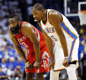 Photo - Houston's James Harden (13) and Kevin Durant (35) rest their hands on their knees during Game 2 in the first round of the NBA playoffs between the Oklahoma City Thunder and the Houston Rockets at Chesapeake Energy Arena in Oklahoma City, Wednesday, April 24, 2013. Oklahoma City won, 105-102. Photo by Nate Billings, The Oklahoman