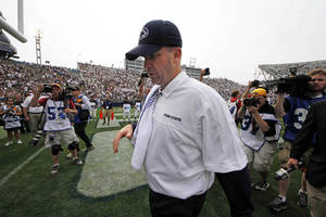 Photo -   Penn State head coach Bill O'Brien walks off the field after an NCAA college football game against Ohio at Beaver Stadium in State College, Pa., Saturday, Sept. 1, 2012. Ohio won 24-14. (AP Photo/Gene J. Puskar)