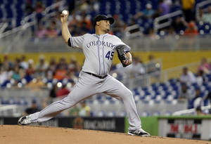 Photo - Colorado Rockies' Jhoulys Chacin delivers a pitch during the first inning of a baseball game against the Miami Marlins, Friday, Aug. 23, 2013, in Miami. (AP Photo/Wilfredo Lee)