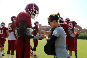 Photo - OU director of Sports Nutrition Tiffany Byrd talks to players during a recent practice. PHOTO BY ANDREW LENTZ, Courtesy OU Athletics Communications <strong></strong>
