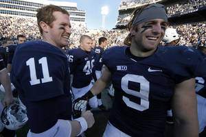 Photo -   Penn State quarterback Matt McGloin (11) and running back Michael Zordich (9) celebrate after a 45-22 win over Indiana in an NCAA college football game in State College, Pa., Saturday, Nov. 17, 2012. (AP Photo/Gene J. Puskar)