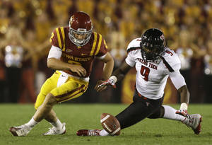 Photo -   Iowa State quarterback Steele Jantz, left, fumbles the ball in front of Texas Tech linebacker Branden Jackson, right, during the second half of an NCAA college football game, Saturday, Sept. 29, 2012, in Ames, Iowa. Texas Tech recovered the fumble. Texas Tech won 24-13. (AP Photo/Charlie Neibergall)