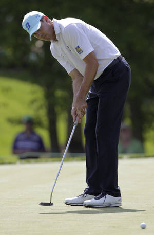Photo - Matt Kuchar putts on the seventh hole during the pro-am for the the Memorial golf tournament Wednesday, May 28, 2014, in Dublin, Ohio. (AP Photo/Jay LaPrete)