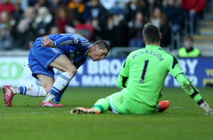 Photo - Chelsea's Fernando Torres, left, celebrates his goal past Hull City's goalkeeper Allan McGregor, right, during their English Premier League soccer match at the KC Stadium, Hull, England, Saturday, Jan. 11, 2014. (AP Photo/Scott Heppell)
