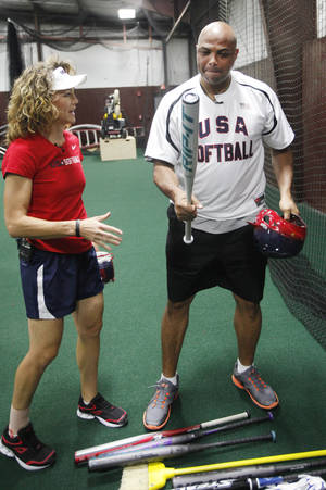 Photo - Former Oklahoma State player and Olympic gold medalist Michele Smith talks with Charles Barkley at the Edmond Memorial High School baseball hitting facility in Edmond, Wednesday, June 6, 2012. Barkley was hitting pitches from Smith during a pre-game show for TNT. Photo By Steve Gooch, The Oklahoman