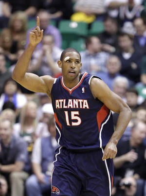 Photo - Atlanta Hawks' Al Horford points gestures after scoring in the second half during an NBA basketball game against the Utah Jazz on Wednesday, Feb. 27, 2013, in Salt Lake City. The Hawks defeated the Jazz 102-91. (AP Photo/Rick Bowmer)