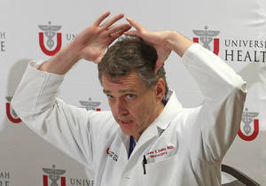 Photo - University of Utah neurosurgeon Andrew Dailey describes the injury of Lais Souza during a news conference at the University of Utah Thursday, Jan. 30, 2014, in Salt Lake City. Doctors say the Brazilian gymnast expected to compete in freestyle skiing at the Sochi Olympics is unable to move, talk or breathe on her own after an accident this week while skiing in Utah.  She was injured Monday when she hit a tree while skiing in Park City. (AP Photo)