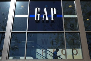 photo - In this Tuesday, Feb. 26, 2013, photo, a shopper walks down the steps at a Gap store in Los Angeles.  Gap Inc. reported a 61 percent increase in fourth-quarter profits Thursday, Feb. 28, 2013, capping a strong year that saw the company's turnaround take hold. (AP Photo/Jae C. Hong)