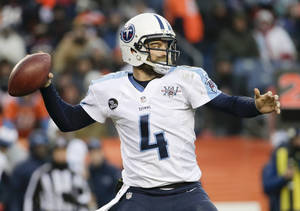 Photo - Tennessee Titans quarterback Ryan Fitzpatrick throws against the Denver Broncos during the second half of an NFL football game on Sunday, Dec. 8, 2013, in Denver. (AP Photo/Jack Dempsey)