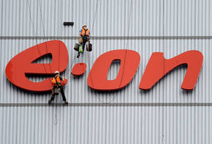 Photo -   FILE - In this Aug. 3, 2011 file photo workers clean the company's logo at a building of E.On in Datteln, western Germany. German electricity and gas supplier E.ON AG on Tuesday Nov. 13, 2012 lowered its earnings forecast for next year because of economic uncertainties and changes in the energy industry, an announcement that caused its shares to tumble. The reduced forecast came as the utility, which is based in Duesseldorf, reported a euro 179 million ($228 million) loss for the third quarter. (AP Photo/dapd/Volker Hartmann, File)