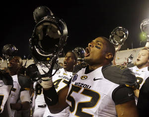Photo - Missouri's Michael Sam (52) sings the school song after Missouri defeated Indiana, 45-28, in an NCAA college football game Saturday, Sept. 21, 2013, in Bloomington, Ind. (AP Photo/Darron Cummings)