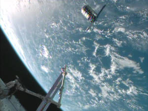 Photo - This framegrabbed image provided by NASA-TV shows the Cygnus spacecraft at the 30 meter hold point from the International Space Station Sunday Sept. 29, 2013 as both cross over the Atlantic Ocean. (AP Photo/NASA-TV)