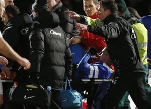 Photo - Everton's Bryan Oviedo is carried off the pitch after an injury during their English FA Cup fourth round soccer match against Stevenage at the Lamex Stadium, Stevenage, England, Saturday, Jan. 25, 2014. (AP Photo/Sang Tan)