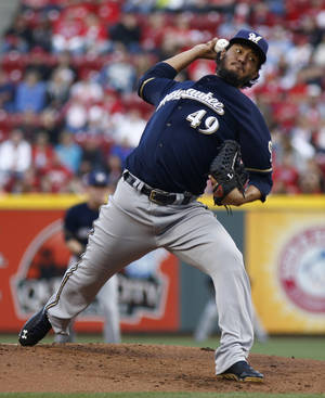Photo - Milwaukee Brewers starting pitcher Yovani Gallardo throws against the Cincinnati Reds during the first inning of a baseball game, Saturday, May 3, 2014, in Cincinnati. (AP Photo/David Kohl)