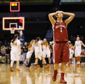 Photo - Oklahoma's Nicole Kornet (1) reacts after a Big 12 women's basketball tournament game between the OU Sooners and Texas at the Chesapeake Energy Arena in Oklahoma City, Saturday, March 8, 2014. UT won, 82-72. Photo by Nate Billings, The Oklahoman