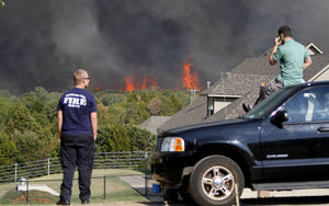 photo - A crowd watches as flames from a wildfire approach homes near NW 122nd and Midwest Blvd. in Oklahoma City, Wednesday, August 31, 2011. Photo by Bryan Terry, The Oklahoman