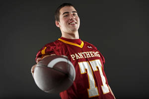 Photo - All-State football player Daniel Burton, of Putnam City North, poses for a photo in Oklahoma CIty, Wednesday, Dec. 14, 2011. Photo by Bryan Terry, The Oklahoman