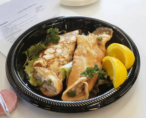 photo - These creamy chicken-filled crepes prepared by Arielle Quartuccio, 11, of Norman, were awarded a blue ribbon  by judges during the Shawnee Mills'  Kids' Pancakes, Flapjacks and Griddle Cakes Contest at the Oklahoma State Fair on Saturday, Sep. 22, 2012. Photo by Jim Beckel, The Oklahoman.