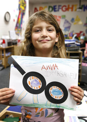 Photo - Kindergartner Adrianna Mestanza, 5, holds up her giraffe artwork using the number 100 to celebrate the 100th day of school at James L. Dennis Elementary School.  Photo by Paul B. Southerland, The Oklahoman