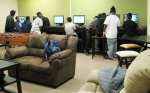 Photo - Youth in Oklahoma City's FACT program use the Hathaway Center's computers before dinner and the night's program gets under way.