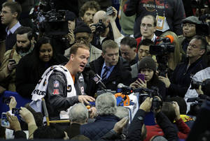 Photo - Denver Broncos' Peyton Manning answers questions during media day for the NFL Super Bowl XLVIII football game Tuesday, Jan. 28, 2014, in Newark, N.J. (AP Photo/Charlie Riedel)