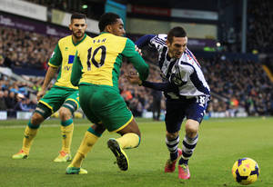 Photo - West Bromwich Albion's Morgan Amalfitano, right, turns and beats Norwich City's Leroy Fer, center, during their English Premier League soccer match at The Hawthorns, West Bromwich, England, Saturday, Dec. 7, 2013. (AP Photo/Nick Potts, PA Wire)  UNITED KINGDOM OUT  -  NO SALES  -  NO ARCHIVES