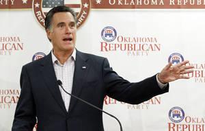 Photo -   Republican presidential candidate former Massachusetts Gov. Mitt Romney, gestures as he speaks to supporters at Oklahoma state Republican Party Headquarters in Oklahoma City, Wednesday, May 9, 2012. Romney repeated his view that marriage should be restricted to one man and one woman, highlighting a sharp contrast with President Barack Obama. (AP Photo/Sue Ogrocki)