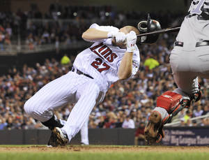 Photo -   Minnesota Twins' Chris Parmelee goes down after he was hit in the helmet by a pitch from Boston Red Sox pitcher Justin Thomas in the sixth inning of a baseball game Wednesday, April 25, 2012, in Minneapolis. Parmelee left the game. (AP Photo/Jim Mone)