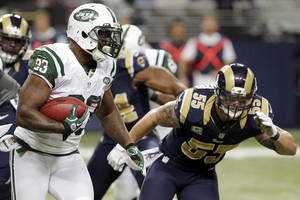 Photo -   New York Jets running back Shonn Greene, left, carries the ball before being brought down by St. Louis Rams middle linebacker James Laurinaitis, right, during the third quarter of an NFL football game, Sunday, Nov. 18, 2012, in St. Louis. (AP Photo/Seth Perlman)