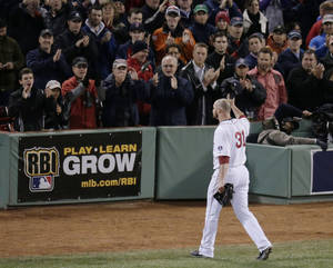 Photo - Boston Red Sox starting pitcher Jon Lester acknowledges the crowd as he leaves the game during the eighth inning of Game 1 of baseball's World Series against the St. Louis Cardinals Wednesday, Oct. 23, 2013, in Boston. (AP Photo/Charlie Riedel)
