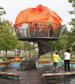Photo - Children play inside a giant pumpkin at Pumpkinville at the Myriad Botanical Gardens in Oklahoma City. Photo by  Paul Hellstern, The Oklahoman <strong>PAUL HELLSTERN - Oklahoman</strong>