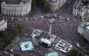 Photo -   Floats carrying British Olympic and Paralympic athletes take part in a parade as seen from the air as they pass Trafalgar Square, London, Monday, Sept. 10, 2012. Thousands of people waving British flags lined the streets of London on Monday to toast the athletes behind the country's unprecedented summer of sporting success. (AP Photo/Peter Macdiarmid, Pool)
