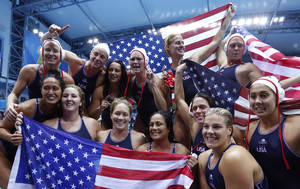 Photo -   Members of the United States women's water polo team celebrate after winning the gold medal match against Spain at the 2012 Summer Olympics, Thursday, Aug. 9, 2012, in London. (AP Photo/Alastair Grant)