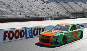 Photo - Driver Danica Patrick (10) rolls down pit road after hitting the wall during practice for the NASCAR Sprint Cup series auto race at Bristol Motor Speedway on Friday, March 14, 2014, in Bristol, Tenn. (AP Photo/Wade Payne)
