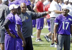 Photo - Minnesota Vikings wide receiver Jarius Wright, right  listens in as wide receiver coach George Stewart talks to wide receivers Jerome Simpson, left, and Greg Jennings during the NFL football training camp, Wednesday, Aug. 7, 2013 in Mankato, Minn. Stewart is being counted on to help a new look receiver corps get up to speed in training camp. (AP Photo/Jim Mone)