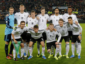 Photo - FILE - In this Oct 11, 2013 file photo, Germany soccer team poses prior to the start the World Cup Group C qualifying soccer match between Germany and Ireland in Cologne, Germany. Background from left: Manuel Neuer, Per Mertesacker, Toni Kroos. Marcell Jansen, Sami Khedira and Jerome Boateng. Foreground from left: Philipp Lahm, Thomas Mueller, Andre Schuerrle, Bastian Schweinsteiger and Mesut Ozil. (AP Photo/Michael Probst, File) - SEE FURTHER WORLD CUP CONTENT AT APIMAGES.COM