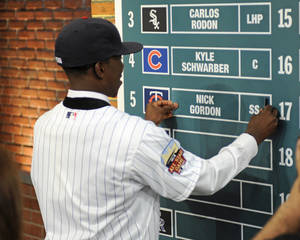 Photo - Shortstop Nick Gordon from Olympia high school in Windemere, Florida puts his name onto the board after being selected by the Minnesota Twins with the fifth pick in the 2014 MLB baseball draft Thursday, June 5, 2014, in Secaucus, N.J. (AP Photo/Bill Kostroun)