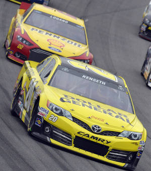 Photo - Matt Kenseth (20) drives past Joey Logano (22) during the NASCAR Sprint Cup series auto race at Chicagoland Speedway in Joliet, Ill., Sunday, Sept. 15, 2013. (AP Photo/Warren Wimmer)