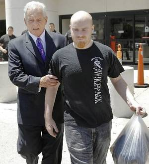 Photo - Attorney Irven Box, left, walks with Justin Adams after Adams was released July 25 on $100,000 bond from the Oklahoma County jail in Oklahoma City. Photo by Chris Landsberger, The Oklahoman Archvies