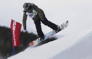 Photo - Jamie Anderson launches off a jump during the women's slopestyle snowboarding final at the Dew Tour iON Mountain Championships, Friday, Dec. 13, 2013, in Breckenridge, Colo. Anderson won the event (AP Photo/Julie Jacobson)
