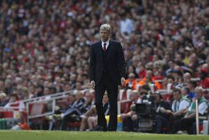 Photo - Arsenal's manager Arsene Wenger watches his team play against West Bromwich Albion during their English Premier League soccer match at Emirates Stadium in London, Sunday, May 4, 2014. (AP Photo/Sang Tan)