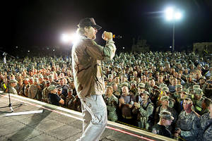 Photo - Country music superstar Toby Keith takes the stage Wednesday to show his support and perform for 1,000 service members at Camp Speicher in Iraq.  Photo provided by Dave Gatley, USO