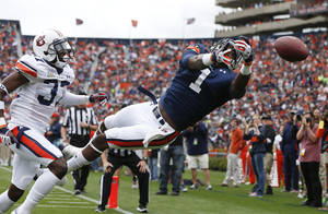 Photo - Auburn wide receiver Trovon Reed (1) cannot make the catch as Auburn defensive back Kamryn Melton (37) defends in the first half of the annual A Day spring intrasquad NCAA college football game on Saturday, April 19, 2014, in Auburn, Ala. (AP Photo/John Bazemore)