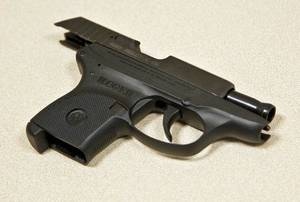 Photo - A .380 handgun at the Mustang Police Department on Friday, Sept. 23, 2011 in Mustang, Okla. that is similar to the one found at the scene of the shooting death of longtime Nichols Hills Fire Chief Keith Bryan.Photo by Chris Landsberger, The Oklahoman  ORG XMIT: KOD