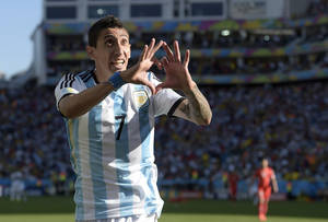 Photo - Argentina's Angel di Maria celebrates after scoring his side's only and winning goal in extra time during the World Cup round of 16 soccer match between Argentina and Switzerland at the Itaquerao Stadium in Sao Paulo, Brazil, Tuesday, July 1, 2014. Argentina defeated Switzerland 1-0 to move on to the quarterfinals. (AP Photo/Manu Fernandez)