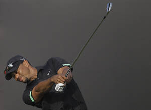 Photo - Tiger Woods from the U.S. tees off on the 15th hole during the second round of the Dubai Desert Classic golf tournament in Dubai, United Arab Emirates, Friday Jan. 31, 2014. (AP Photo/Kamran Jebreili)